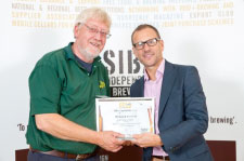 Elgood's Head Brewer Alan Pateman receiving the Gold Award for Cherry Wheat from Mike Benner of SIBA.