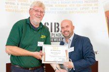 Alan receiving the Gold Award for Warrior from Tony Jerome of SIBA