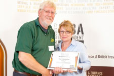 Alan receiving the Silver Overall award from Alison Hughes of Beatson Clark